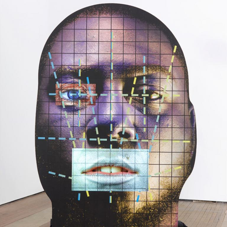 "Tony Oursler, ""CV(15),"" wood, inkjet print, LCD screens, USB flash drives, sound performed by Jason Scott Henderson and Joanna Smolenski, 106"" x 71.5"" x 30.5"", 2015. Courtesy of the artist and Lehmann Maupin, New York and Hong Kong."