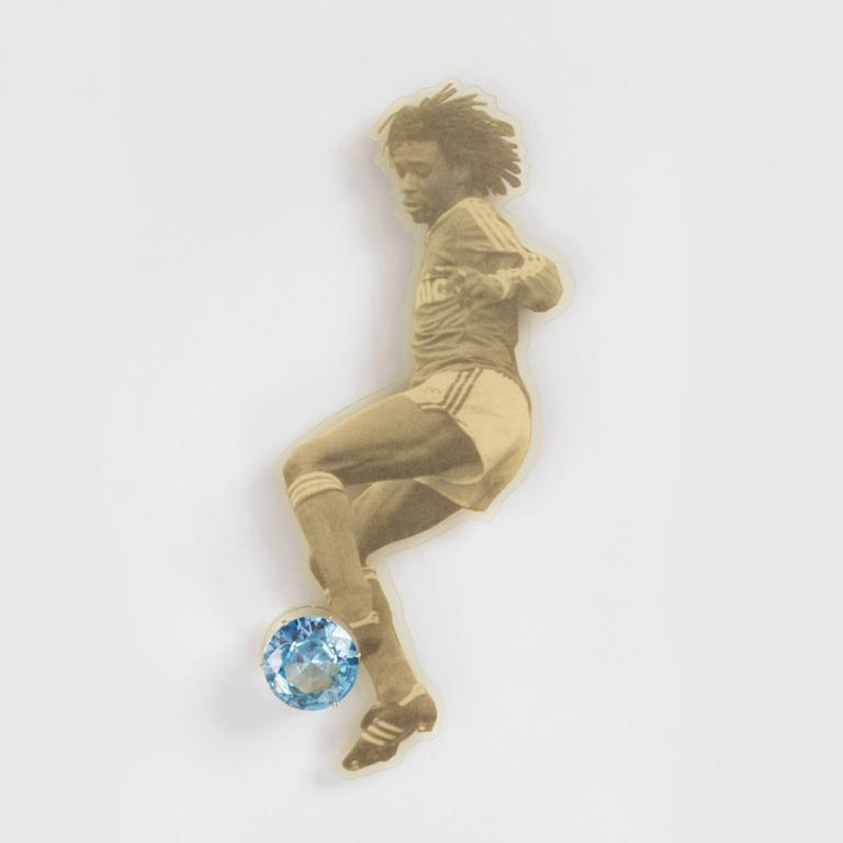 "Gijs Bakker, ""Blinker Brooch"" from the ""Sportfiguren (Sports Figures)"" series, 1988, executed by Tobias van Roojen, gold, aquamarine and PVC-laminated newspaper; 6 1/2 in x 2 9/16 in x 11/16 in."